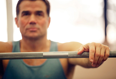 493ss_thinkstock_rf_man_resting_on_weight_bar